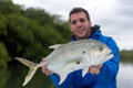 Fisherman holding a Crevalle jack Royalty Free Stock Photo