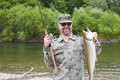 Fisherman holds caught pink salmon Royalty Free Stock Photos