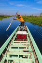 Fisherman inle lake in myanmar burmar is rowing with blue sky Royalty Free Stock Photo