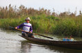 Fisherman on Inle lake rowing his canoe on the wat Royalty Free Stock Photo