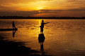 Fisherman of Lake in action when fishing, Thailand Royalty Free Stock Photo