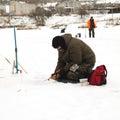 Fisherman on the lake ice fishing rod Royalty Free Stock Photo