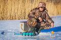 Fisherman on a lake at winter Royalty Free Stock Photo