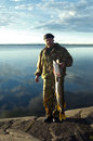 Fisherman with a large fish. Royalty Free Stock Photo