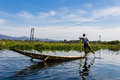 Fisherman with leg rowing inle lake in myanmar burmar blue sky Royalty Free Stock Photos