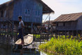 Fisherman with leg rowing inle lake in myanmar burmar and floating village Stock Photos