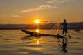 Fisherman with leg rowing during sunset inle lake in myanmar burmar Stock Photo