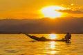 Fisherman with leg rowing during sunset inle lake in myanmar burmar Stock Photos