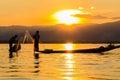 Fisherman with leg rowing during sunset inle lake in myanmar burmar Royalty Free Stock Image