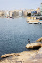 Fisherman in malta on the shore of slima Stock Photos