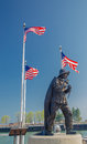Fisherman memorial three american flags flying over the in port washington wisconsin Royalty Free Stock Photos