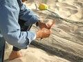 Fisherman mending the fishing net Royalty Free Stock Image