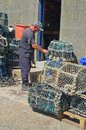 Fisherman mending his pots in Newlyn Harbour Royalty Free Stock Photo