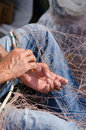 Fisherman mending his fishing nets in cartagena spain Stock Photo