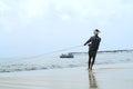 Fisherman pulls his fishing boat