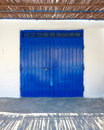 Fisherman's boat house blue door Royalty Free Stock Photo