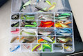 A fisherman's tackle box with lures and gear for fishing Royalty Free Stock Photo