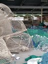 Fishing nets, lobster Pots and Floats, all get prepred for the days work at sea. Royalty Free Stock Photo