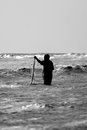 Fisherman silhouette with a net at the sea Royalty Free Stock Photo