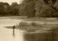 Fisherman a single cast his line in the maumee river in northwest ohio photo has been given an oil paint effect in photoshop Stock Photography