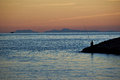 Fisherman a sitting near the seashore of side turkey Royalty Free Stock Images