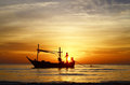 Fisherman at sunrise silhouette of on boat in the hua hin thailand Royalty Free Stock Photos