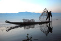 Fisherman working in inle lake myanmar february silhouette of traditional wooden boat using a coop like trap with net to catch Stock Image
