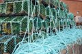 Fishermans lobster pots on on the dock side Royalty Free Stock Photo