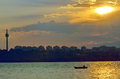 Fishermen in boat at sunset on danube river Royalty Free Stock Images