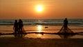 Fishermen dragged ashore network sunset the arabian sea Royalty Free Stock Photo