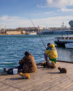 Fishermen on fishing from a pier Grafskoy landing stage in Sevastopol Royalty Free Stock Photo
