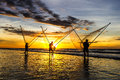 Fishermen fishing in the sea at sunrise Royalty Free Stock Photo