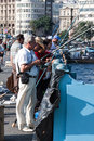 Fishermen istanbul a line of on galata bridge fishing on the golden horn turkey Royalty Free Stock Image