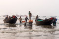 Fishermen loading fish from trawlers Royalty Free Stock Photo