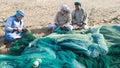 Fishermen in Oman preparing nets Royalty Free Stock Photo