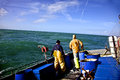 Fishermen in rough sea Royalty Free Stock Photo