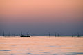Fishermen at sunrise on black sea Stock Images