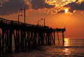 Fishermen at sunrise on a fishing pier Stock Image