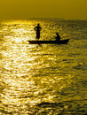 Fishermen at sunset Royalty Free Stock Photo