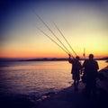 FISHERMEN IN SUNSET Royalty Free Stock Photo