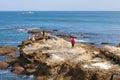 Fishermen and swim arabic school boys in tangier morocco march are on the coastal rocks Stock Image