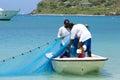Fishermen in tortola caribbean fishemen boat and nets british virgin island Royalty Free Stock Images