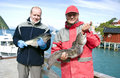 Fishermen and trophy Royalty Free Stock Photo