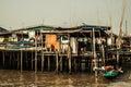 Fishery community house and ship near sea at thailand Royalty Free Stock Photos
