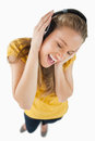 Fisheye view of a blonde girl enjoying music with headphones Royalty Free Stock Images
