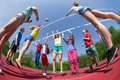 Fisheye view of teens playing volleyball outside on the court during summer sunny day Stock Image