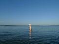 Fishing Area signage on Buoy on large lake Royalty Free Stock Photo