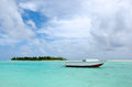 Fishing boat in aitutaki lagoon cook islands small Stock Photo
