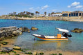 Fishing boat at ancient port caesarea israel built by the crusaders during the crusades Royalty Free Stock Photo