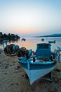 Fishing boat on a beach in front of ruins of a roman fortress at sunset, Sithonia Royalty Free Stock Photo